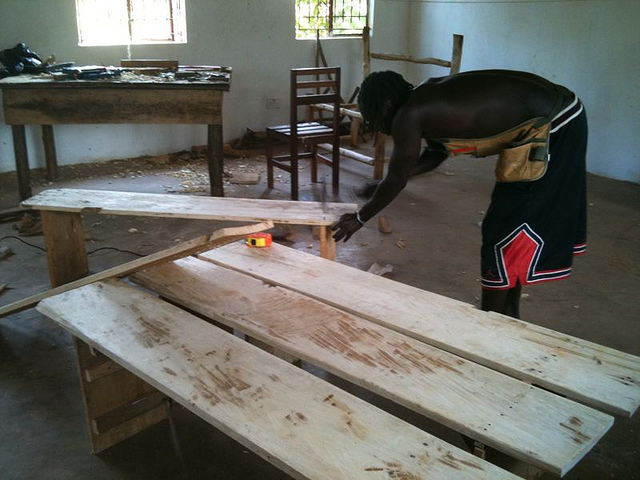 Brian rebuilding benches for the classroom